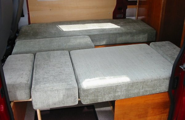 single beds with cushion in use as table