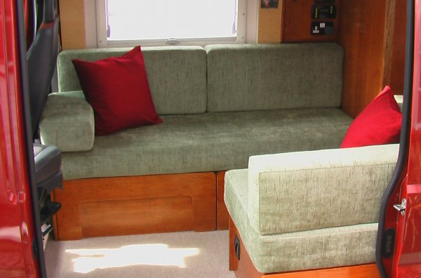 view of sofa/bed and small seat/bed
