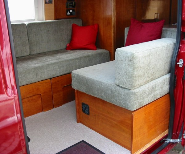 view of sofa and single seat